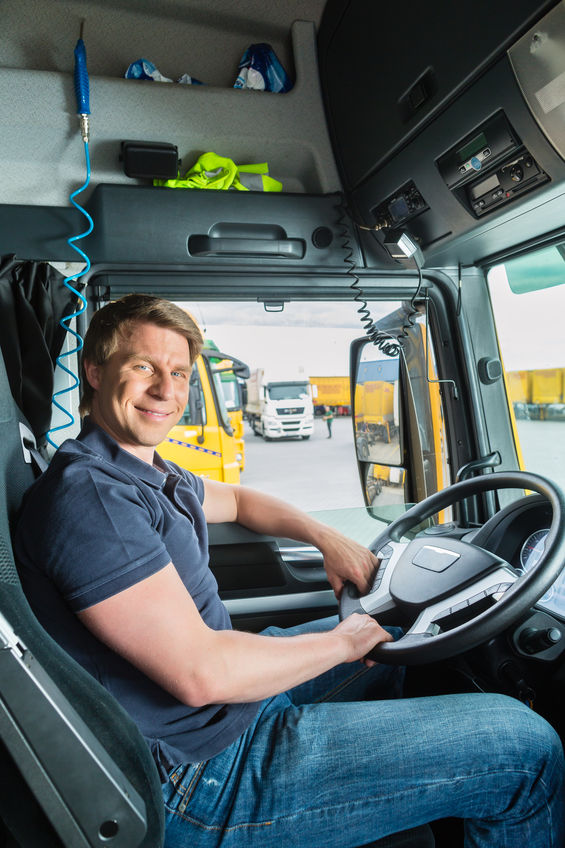 Man sitting in the cab of a semi truck