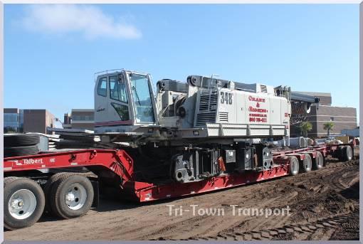 lowboy trailer loaded with a huge crane