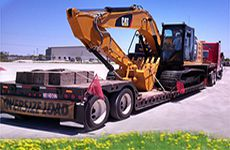 Specialized Freight & Oversized Freight Shipping - Backhoe Loaded onto a Truck