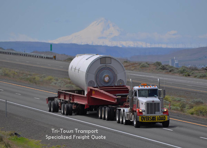 a very large piece of power generation equipment loaded on a flatbed trailer