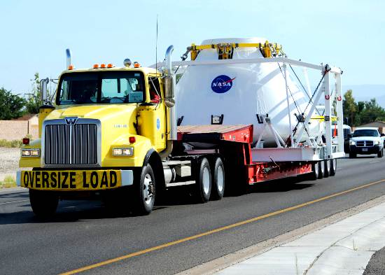 Image of NASA's next generation of a manned-spacecraft enroute to White Sands Missile Range as an oversized load.